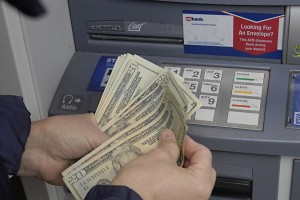 Female cash money fro USbank's atm cash machine