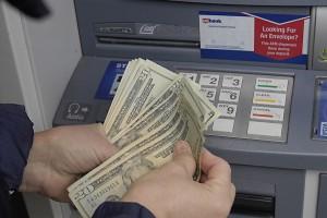 Female cash money fro USbank's atm cash machine